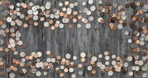 El dinero del marco acuña el fondo imagenes de archivo