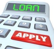 El dinero del préstamo de la calculadora de la palabra de préstamo aplica el banco del financiamiento Foto de archivo libre de regalías