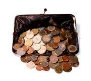 El dinero desbordó un monedero abierto Fotos de archivo