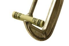 El dinero es apretado Imágenes de archivo libres de regalías
