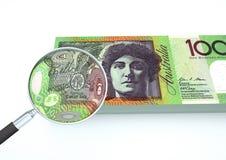 el dinero rendido 3D de Australia con la lupa investiga moneda aislada en el fondo blanco Foto de archivo