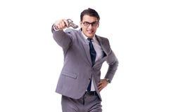 El director empresarial agresivo con la arma de mano aislada en blanco imagenes de archivo