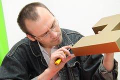 El diseñador produce la carta tridimensional. Imagen de archivo