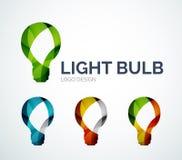 El diseño del logotipo de la bombilla hecho de color junta las piezas Fotografía de archivo