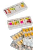 El dispensador y las tabletas de la píldora Foto de archivo