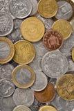 El diverso dinero acuña el fondo Fotografía de archivo