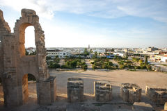 El Djem, Amphitheatre with city skyline. Unfinished part of roman biggest amphitheater in africa with city skyline of El Djam in the background, Tunisia royalty free stock photo