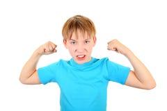 El doblar de músculo del niño Fotografía de archivo libre de regalías