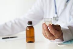El doctor With Cough Syrup Imagen de archivo
