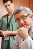 El doctor de sexo masculino With Hand On Chin foto de archivo