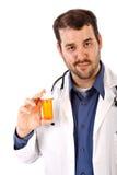 El doctor de sexo masculino Holding Empty Drug Bottle Imagen de archivo libre de regalías