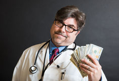 ¡El doctor Displaying Cash! Imagen de archivo