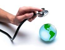 El doctor examina la salud de la tierra Imágenes de archivo libres de regalías