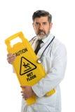 El doctor Holding Caution Sign Imágenes de archivo libres de regalías