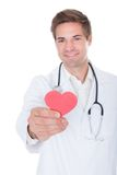 El doctor Holding Heart Fotografía de archivo libre de regalías