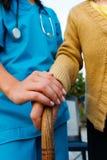 El doctor que cuida y señora mayor Hands Imagen de archivo libre de regalías