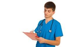 El doctor serio da la prescripción Foto de archivo libre de regalías