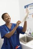 El doctor Wearing Disposable Glove Imagen de archivo libre de regalías