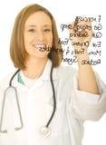 El doctor Writing Healthy Life Plan Imágenes de archivo libres de regalías