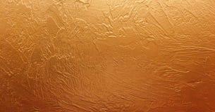 El documento de información del oro, textura es color oro sólido apenado viejo vintage con la pintura áspera del grunge de la pel foto de archivo libre de regalías