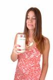 El doesnât de la muchacha tiene gusto de la leche. Fotos de archivo