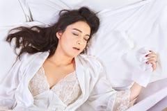 El dormir cuando gripe cogida Fotografía de archivo