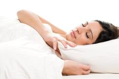 El dormir de la mujer joven Imagen de archivo libre de regalías