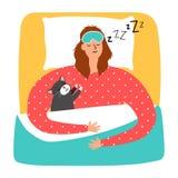 El dormir de la mujer y del gato Imagen de archivo libre de regalías