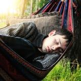 El dormir del hombre joven Fotografía de archivo libre de regalías