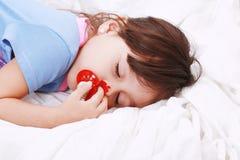 El dormir dulce de la niña Fotografía de archivo