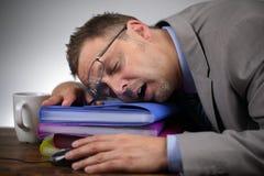 El dormir en el trabajo Foto de archivo libre de regalías