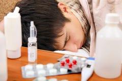 El dormir enfermo del adolescente Fotos de archivo