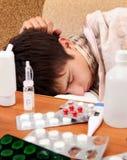 El dormir enfermo del adolescente Fotografía de archivo libre de regalías