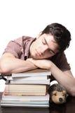 El dormir masculino adolescente en los libros Fotografía de archivo