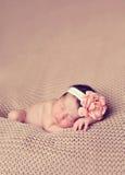El dormir planteado niño Imagenes de archivo