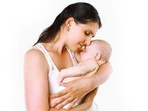 El dormir sensual de la mamá y del bebé foto de archivo