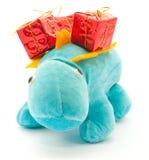 El dragón con los regalos de la Navidad Foto de archivo
