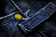 El dril de algodón desgastado jadea el botón imagen de archivo