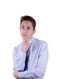 El dudar adolescente del muchacho Aislado en blanco Fotografía de archivo