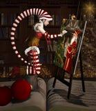 El duende de la Navidad está pintando un retrato de Santa Claus ilustración del vector
