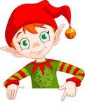 El duende de la Navidad invita y coloca a la tarjeta Foto de archivo libre de regalías