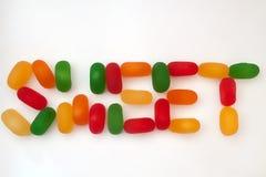El dulce de la palabra en el fondo blanco Fotos de archivo libres de regalías