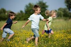 El ejecutarse de los niños Fotografía de archivo libre de regalías