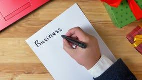 El ejemplo, Año Nuevo, mano del hombre escribe en un cuaderno, metas 2019 de negocio libre illustration