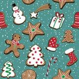 El ejemplo del vector de las galletas de la Navidad fijó en fondo azul con nieve Modelo inconsútil Fotos de archivo