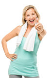 El ejercicio maduro sano de la mujer manosea con los dedos para arriba aislado en el backgr blanco Imagen de archivo