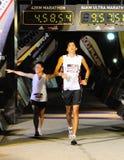 El el largo y corto del maratón del ocaso de Adidas Fotografía de archivo