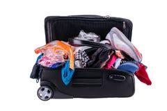 El embalar a ir el las vacaciones aisladas en el fondo blanco foto de archivo libre de regalías