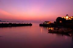 El embarcadero en la puesta del sol Foto de archivo