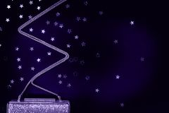 El embrague de oro de la tarde festiva con la estrella asperja en negro Holi Foto de archivo